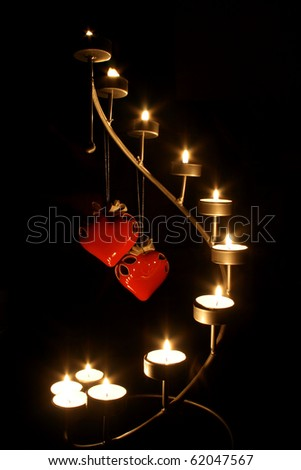 two hearts stand the candleholder candlelight - stock photo