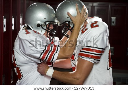 Two High School football players - stock photo