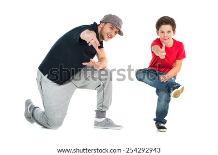 Two hip hop dancers isolated on white background. small boy and adult man dancing together - stock photo