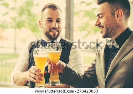 Two hipsters Drinking beer - stock photo