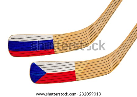 Two hockey sticks and featuring the flags of the teams - stock photo