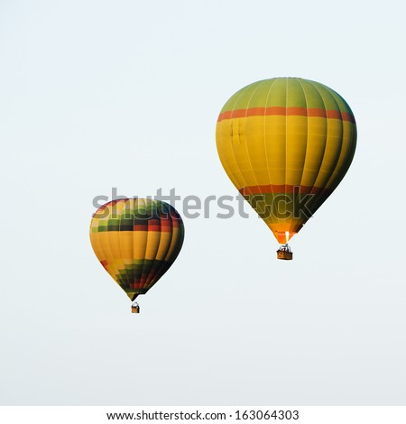 Two hot air balloons in the sky, Pushkar, Ajmer, Rajasthan, India - stock photo