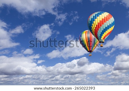 Two Hot Air Balloons Up In The Beautiful Blue Sky. - stock photo