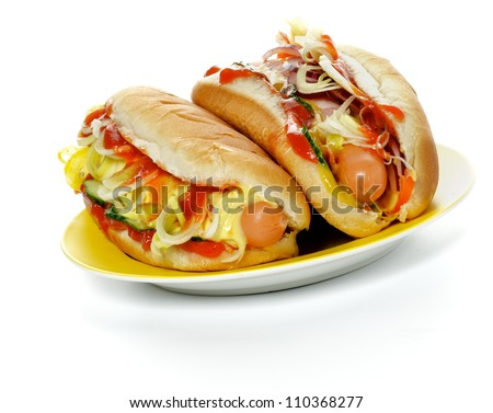 Two Hot Dogs on Yellow Plate isolated on white background - stock photo