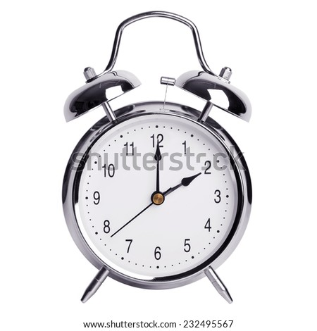 Two hours on a round metal alarm clock - stock photo