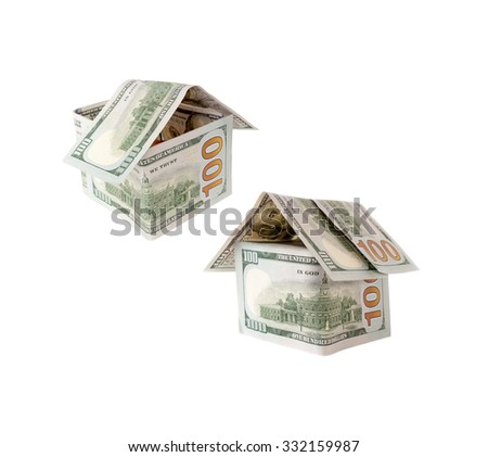 Two Houses of one hundred dollar bills on white.Abstract dollars concept means mortgage or hypothecation - stock photo