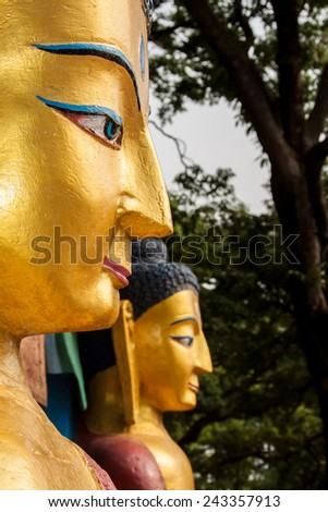 Two huge golden buddhas in Nepal. - stock photo
