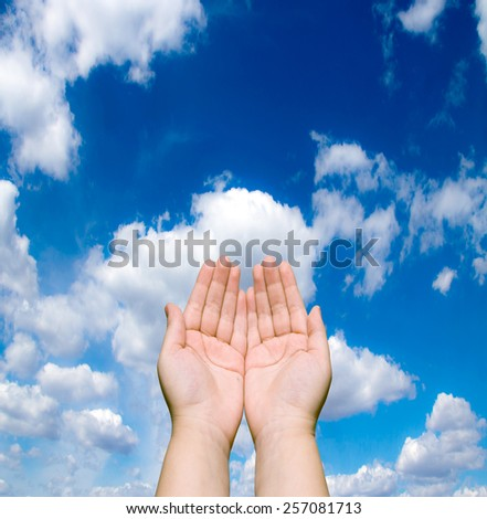 two human hands against the blue sky - stock photo