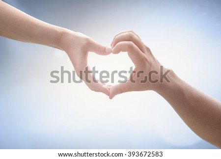 Two Human hands show heart shape. Nurses Share Cupid Image Trust Synergy Pair CSR Kind Water Autism World Ocean Day Help Gift Tied Couple Better God Son Ring Circle Party Card Vows Mother concept. - stock photo