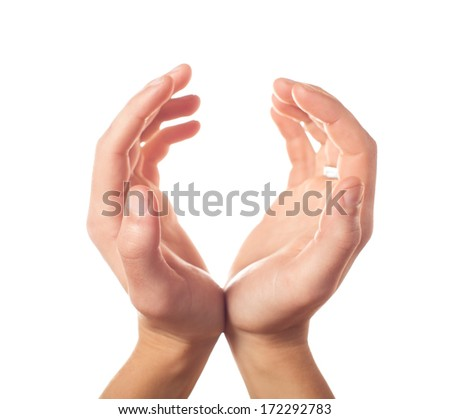 Two human hands showing sphere on white background - stock photo
