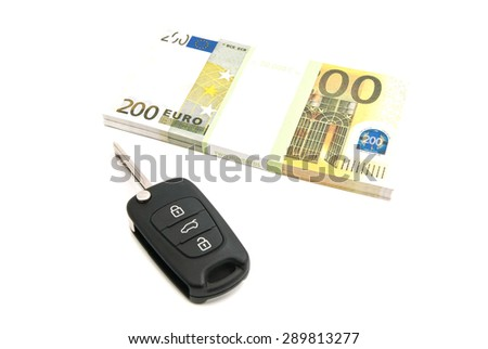 two hundred euros notes and car keys on white - stock photo