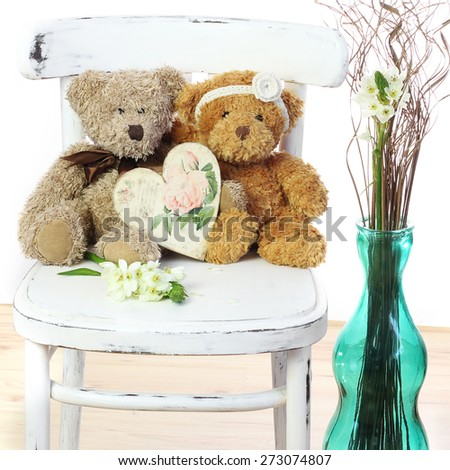 Two in love teddy bears sit on a chair. Wedding  concept - stock photo