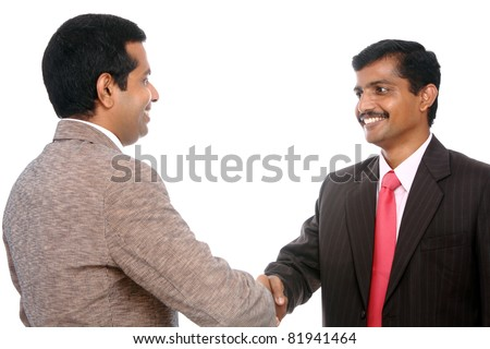 Two Indian business people shaking hands - stock photo
