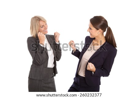 Two isolated businesswoman proud of her success. - stock photo