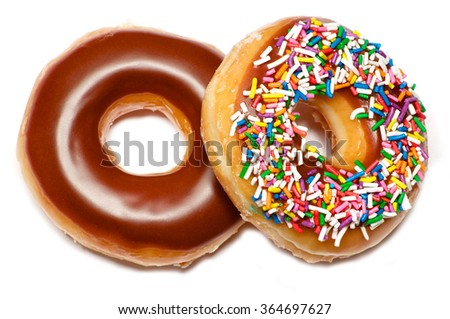 Two isolated chocolate and glazed doughnuts over white - stock photo