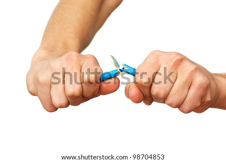 two isolated hands breaking blue pencil over white background - stock photo