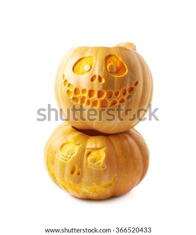 Two Jack-O-Lantern pumpkins isolated - stock photo