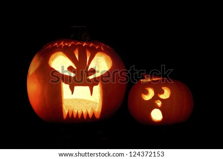 Two Jack-o-lantern's with humorous expressions. - stock photo