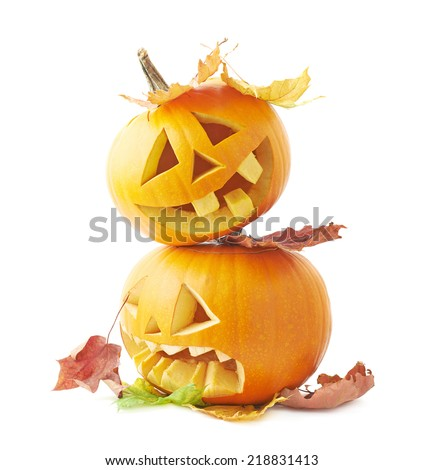 Two Jack-o'-lanterns orange pumpkin heads placed one over another and covered with colorful maple leaves, composition isolated over the white background - stock photo