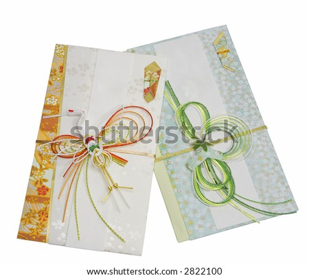 Two Japanese festive envelopes isolated over white background with clipping path.Used to give money in special occasions (weddings,New Year,celebration) - stock photo