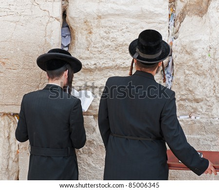 Two jews at the western wall of mourning. Jerusalem. Israel. - stock photo