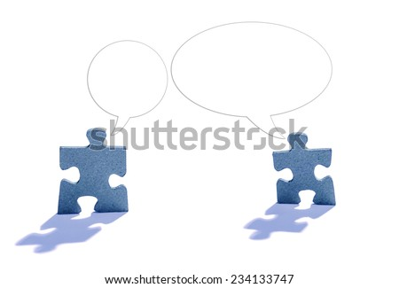 Two jigsaw puzzle pieces in shape of man with talking bubble lit by backlight on white background  - stock photo