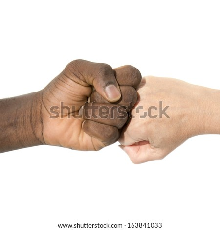 Two joint hands symbolizing diversity - stock photo