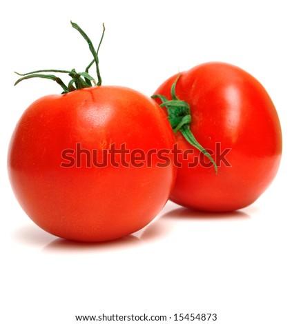 Two juicy fresh tomatoes on white. Isolation. - stock photo