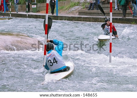 Two kayakers in a competition - stock photo