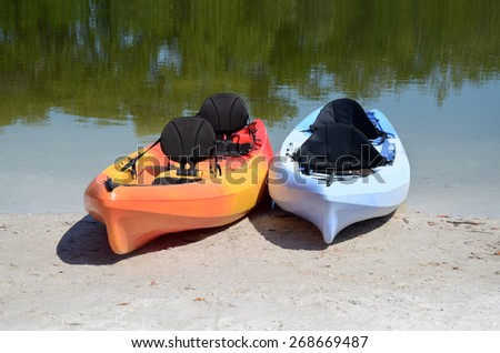 two kayaks on lake shore nature landscape - stock photo