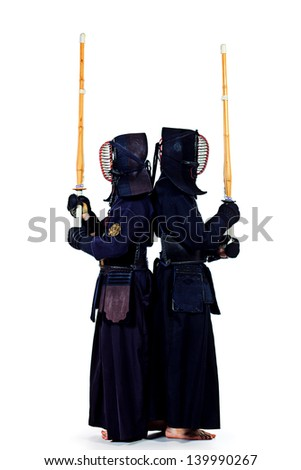 Two kendo fighters posing together over white background. Asian martial arts. - stock photo