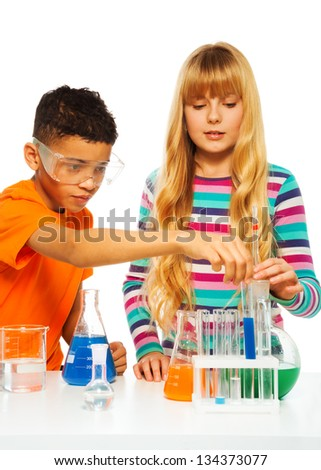 Two kids, black boy and blond girl in science chemistry class with test tubes and flasks, isolated on white - stock photo
