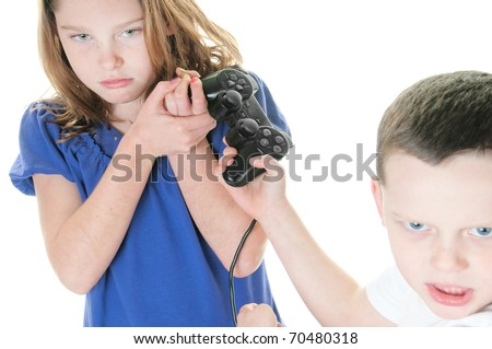 two kids fighting over video console - stock photo