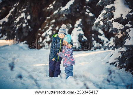 Two Kids in frosty winter Park. Outdoors. - stock photo