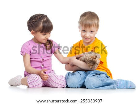 two kids playing with kitten isolated on white - stock photo