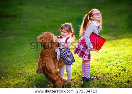 two kids preschooler and kindergarten, back to school outdoor - stock photo