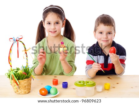 Two kids showing painted easter eggs, isolated on white - stock photo
