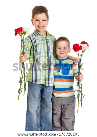 Two kids with carnations for greetings, isolated on white - stock photo