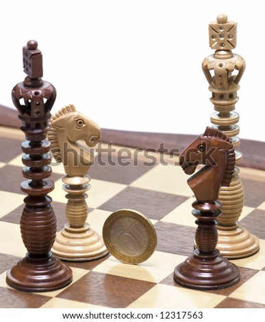 Two Kings and two knights with coin in center. White background. - stock photo