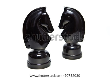 Two knight facing each other on a clear background. - stock photo