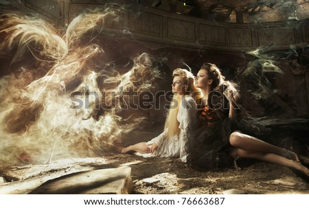 Two ladies and magic bird - stock photo
