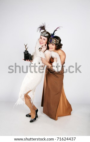 Two ladies from 30s fighting over a phone - stock photo