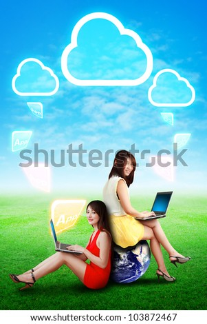 Two lady and Cloud computing icon on the sky : Elements of this image furnished by NASA - stock photo
