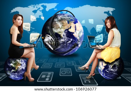 Two lady and world of applications : Elements of this image furnished by NASA - stock photo