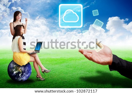 Two lady look at the Cloud computing icon from the hand : Elements of this image furnished by NASA - stock photo
