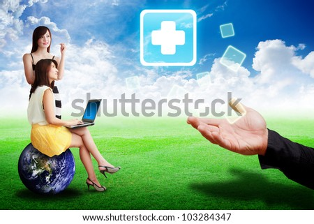 Two lady look at the First Aid icon from the hand : Elements of this image furnished by NASA - stock photo