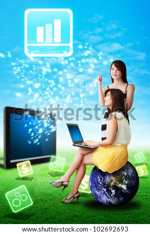 Two lady look at the Graph icon from touch pad : Elements of this image furnished by NASA - stock photo