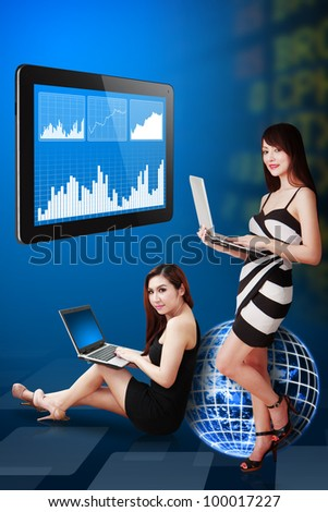 Two lady present the stock exchange graph report : Elements of this image furnished by NASA - stock photo