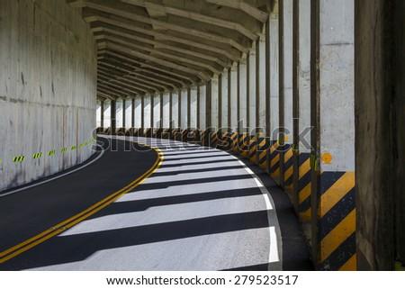 Two lane road tunnel in Taiwan - stock photo