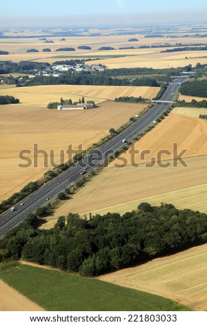 two lanes highway in french farmland - stock photo